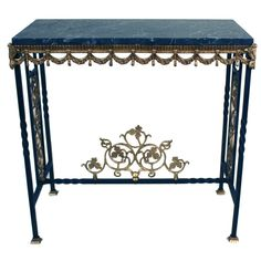 iron and bronze table, with black marble top