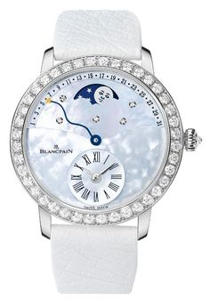 BLANCPAIN RETROGRADE CALENDAR WATCH (Women) • Blancpain's playfully elegant watch channels clear skies with a mother-of-pearl dial set with diamonds and housed within a jewel-studded 18K-white-gold bezel case. Featuring a retrograde calendar and moon-phase tracker, it's perfect for the novice stargazer. Price upon request.