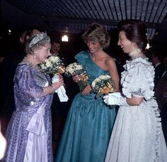 a lovely informal photo of the QM with Princesses Anne and Diana