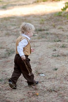 """Hobbit ring bearer with the """"One Ring"""" -- really cute, but my only objection is that the One Ring is evil (not a good connotation for a wedding, lol), plus there are usually two rings to be carried... but you could have a hobbit ring-bearer/s. :) Dress them like the hobbit children at Sam and Rosie's wedding."""