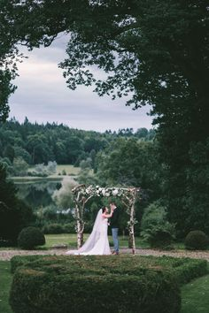 Weddings at Hilton Park are always totally unique, marry under arch in the 300 year old formal gardens