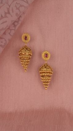 Jewelry OFF! Tiered gold earrings accented with the vibrance of a pink stone. Gold Jhumka Earrings, Gold Bridal Earrings, Gold Wedding Jewelry, Jewelry Design Earrings, Gold Earrings Designs, Gold Jewellery Design, Wedding Necklaces, Jhumka Designs, Girls Earrings