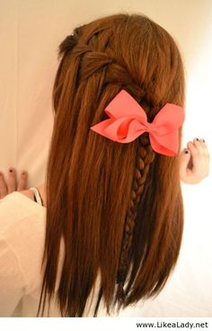 waterfall braid with bow. once you learn how to do a waterfall it becomes simple. Cute look for casual days.  To spice it up curl your hair after doing the braid.