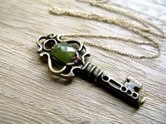 Skeleton key necklace with green stone by Saressa.