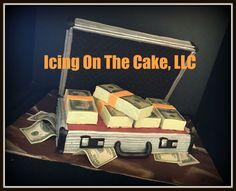 """Briefcase full of money!  Back story on this cake is that there is this little man who I've known his entire life.  Anywho....I find out he's telling his friends that I'm making him a """"stack of money"""" birthday cake; the problem was that I didn't KNOW I was making him a cake.  So...unexpected emense pressure from my little man to prepare a cake to meet the expectations he set for me!!  This is what I came up with!   www.facebook.com/icingonthecake1"""