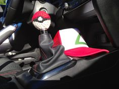 About this Pattern: Pokeball Shift Knob Cover Size: in. in diameter Materials: Red, Black, and White 4 ply acrylic yarn; Crochet Stitches, Crochet Hooks, Crochet Patterns, Crochet Pokemon, Crochet Car, Car Accessories Diy, Sharpie Pens, Single Crochet Stitch, Running Stitch