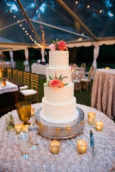 5 tier wedding cake adorned by Coral Floral and accented + Gold Mercury Glass votives + BBJ Champagne Corsage Linen | Classic Southern Wedding at the Legare Waring House by Charleston Wedding Planner ELM Events