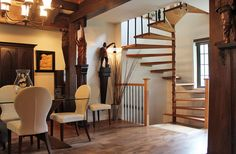 A sculptural spiral staircase opens the space to more light. Sélesta designed the staircase to be safe and child friendly and blend well with the original woodwork.