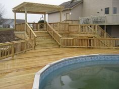 Prefab Above Ground Pool Decks | The large pool deck above includes room for moving around the deck ...