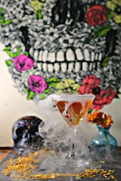 Dia de los Muertos Martini (Marigold Martini) a variation on the martini made with infused marigold vodka, perfect for dia de los muertos - day of the dead.