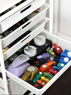 Irma has a lot of punches and other heavy items that she needs to store in her scrapbook room. Inexpensive wire drawers are a wise choice over plastic because they are more durable and less likely to bend./