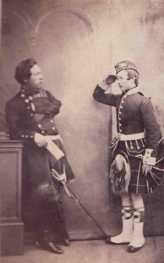 Victorian era military picture of a very young Highlander, possibly a cadet, wearing glengarry cap,  saluting what appears to a war veteran as he is missing his left arm and wearing trews. An interesting picture.