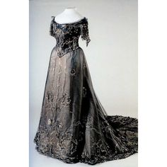 "Sequined and embroidered evening dress of black tulle over white satin by Nadezhda ""Hope"" Lamanova, Russian, early 20th C. Made for Empress Alexandra Feodorovna."
