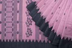 Handwoven Jamdani Cotton sari in a mild pink colored body and a black border, the pallav is finely decorated in black Jamdani work