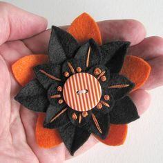 Felt Flower Pin Halloween Black and Orange with Orange and White Striped Button by Dorothy Designs