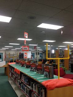 All my displays end up kinda girlie so this is PERFECTION!*** Sports book display with yard markers, end zones and goal posts. School Library Displays, Middle School Libraries, Library Themes, Elementary School Library, Library Activities, Library Design, Library Ideas, Library Decorations, Library Girl