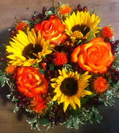 Warm orange and yellow funeral flowers