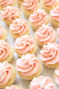 mini lemon cupcakes with swiss meringue buttercream. I had cupcakes from a bake shop in downtown Asheville with Swiss Meringue Buttercream and it was the best frosting I'd ever had :-) Lemon Cupcakes, Yummy Cupcakes, Cupcake Cookies, Pink Cupcakes, Cupcake Toppers, Baby Girl Cupcakes, Muffins Decorados, Just Desserts, Delicious Desserts