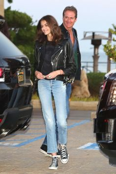 Kaia Gerber wearing Converse Chuck Taylor All Star Hi Sneakers and Re/done High Rise Ankle Crop Jeans