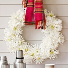Keep your porch warm by hanging your wreath with a festive scarf: http://www.bhg.com/halloween/outdoor-decorations/pretty-front-entry-decorating-ideas-for-fall/?socsrc=bhgpin093014cozyfallmumwreath&page=9