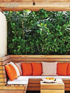 Beauty and the Beach: Lauren Rottet Reinvents  An ipe banquette and table on the lanai.