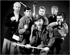 Robert Cornwaite, Dewey Martin, Kenneth Tobey, Dierkes and others pose for a publicity still for the original THE THING