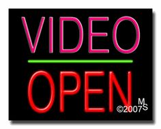 "Video Open Neon Sign - Block Text - 24""x31""-ANS1500-1438-1g  31"" Wide x 24"" Tall x 3"" Deep  Sign is mounted on an unbreakable black or clear Lexan backing  Top and bottom protective sides  110 volt U.L. listed transformer fits into a standard outlet  Hanging hardware & chain included  6' Power cord with standard transformer  Includes 2nd transformer for independent OPEN section control  For indoor use only  1 Year Warranty on electrical components."