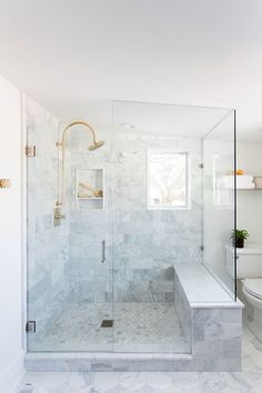 Spring Cleaning: Bathroom on a Budget White marble shower with glass door and brass hardware Master Bathroom Shower, Budget Bathroom, Small Bathroom, Bathroom Renovations, Bathroom Ideas, Master Bathrooms, Bathroom Showers, Bathroom Storage, White Master Bathroom