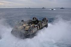 Landing Craft Air Cushion 29, assigned to Naval Beach Unit (NBU) 7, exits the well deck of the amphibious assault ship USS Bonhomme Richard (LHD 6) carrying equipment belonging to the 31st Marine Expeditionary Unit (31st MEU) as they offload to White Beach, Okinawa.