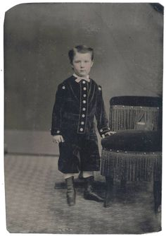 TINTYPE PHOTO PORTRAIT OF YOUNG BOY IN INTERESTING ATTIRE 1860s TO 1870s