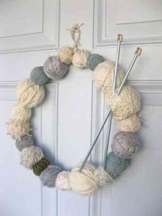 Do you have a passion for knitting? Why not use some of your leftover supplies to make a yarn-ball wreath. You will need a few balls of yarn, a wire coat hanger and a pair of knitting needles. Knitted Christmas Decorations, Christmas Wreaths, Christmas Crafts, Fall Wreaths, Christmas Ornaments, Door Wreaths, Floral Wreaths, Burlap Wreaths, Christmas Door