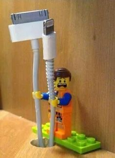 Keep your charger and USB cord from falling off the desk or table with a Lego Man :)