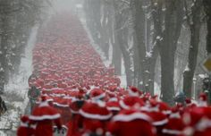 Runners dressed as Father Christmas take part in the so-called 'Nikolaus Run' in the East German town of Michendorf some 40km south-west of Berlin December 9, 2012. Around 800 participants took part in the Santa Claus running competition that is hosted by the Laufclub Michendorf running association. REUTERS-Wolfgang Rattay