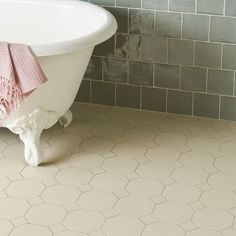 York Victorian Floor Tile Pattern with modified Bronte border in White. Wall: Winchester Tile Company Residence Metropolitan field tiles in Lazul