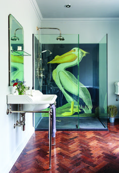 This stunning shower room is really quite normal, with its classic British-style sanitaryware; normal that is, except for the exceptional mural, which gives the room an alternative edge. drummonds-uk.com #neweccentrics