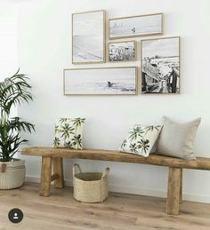 like placement of photos and bench with pillows