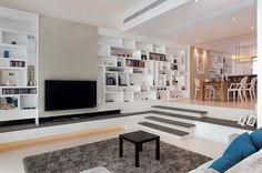 salon en contrebas blanc avec tapis shaggy, S.I.D. Interior Designers