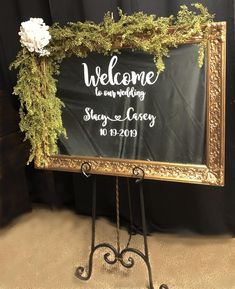 The mirror is a genuine gold antique mirror that measure 40 x 30.   Use it as a Welcome sign or as a Seating Chart. Rent with or without wrought iron easel.   Different Fonts Available.   Floral not included