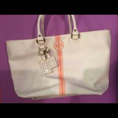 """Tory Burch Tote Bought it 3 years ago/ in good condition/. Coated canvas. Zip closure. Two luggage tags. Interior zip and two additional open pockets. Double shoulder straps with 7"""" drop. 19""""W x 11""""H x 5 1/2""""D. Tory Burch Bags Totes"""