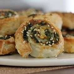 The easiest and crispiest puff pastry Spinach & Feta Pinwheels! These make the perfect party food or super simple lunchbox fillers.
