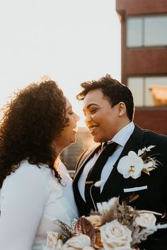 We can't over how cute these two look in their rooftop wedding portraits! | Image by Casey Crowe Photo