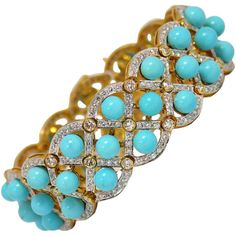 Turquoise Bead Diamond Gold Bracelet. An 18K yellow gold bracelet measuring 7/8 of an inch wide, and beautifully pave set with a total of approximately 9.25ct of round brilliant cut diamonds. Inside the lattice design of the bracelet are 42 turquoise half-drilled beads, each measuring 6mm. This stunning bracelet will fit a medium wrist. c 1990