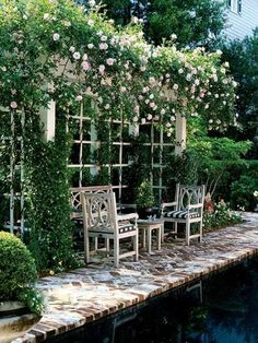 Secret Garden A shallow pergola, thick with roses and jasmine, shades a seating area across the pool. Incorporating these plants into your outdoor room is a great way a add fragrant ambience to the space. Also: brick patio with white sand Outdoor Rooms, Outdoor Gardens, Outdoor Living, Outdoor Seating, Outdoor Sheds, Rustic Outdoor, Small Gardens, The Secret Garden, Secret Gardens