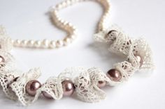 Cream lace threaded with bronze glass pearls and strung on cream freshwater pearls.