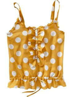 yellow shirt with white polka dots