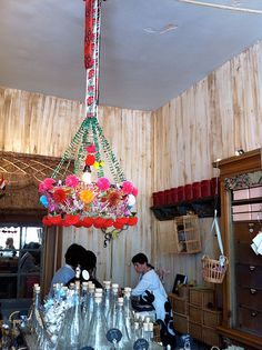 A traditional Polish Paper Chandelier at Bell'occhio in San Francisco via decor8