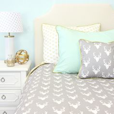 This gray and white deer print is perfect for any big boy's room! The antlers and touch of gold and mint are perfect for transitioning from crib to big kid. Don't forget to add the pillow shams and sq