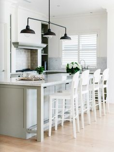 love the light and the footrest on the island... great idea G R E Y and S C O U T: EST MAGAZINE