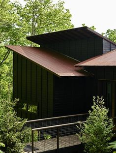A Rustic-Modern Cabin Inspired by Japanese Bungalows and Shou Sugi Ban - Photo 9 of 12 - Like the entry bridge (below), the deck is surrounded by welded-wire fencing made by West Macon Welding.