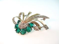 Boucher Sterling Vermeil Pin Emerald Green Flower Swirled Ribbon Clear Rhinestones 1940s Jewelry. $115.00, via Etsy.